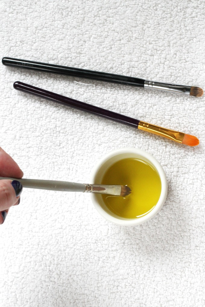 Clean makeup brushes with olive oil - great way to get out stubborn products like concealer and to condition the brush bristles.