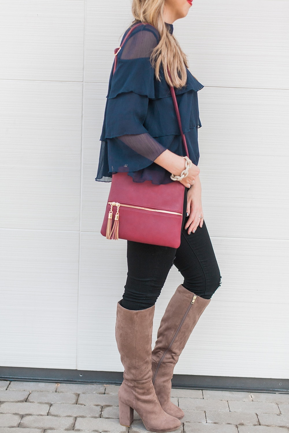 love the details of this outfit - navy ruffle blouse with boots