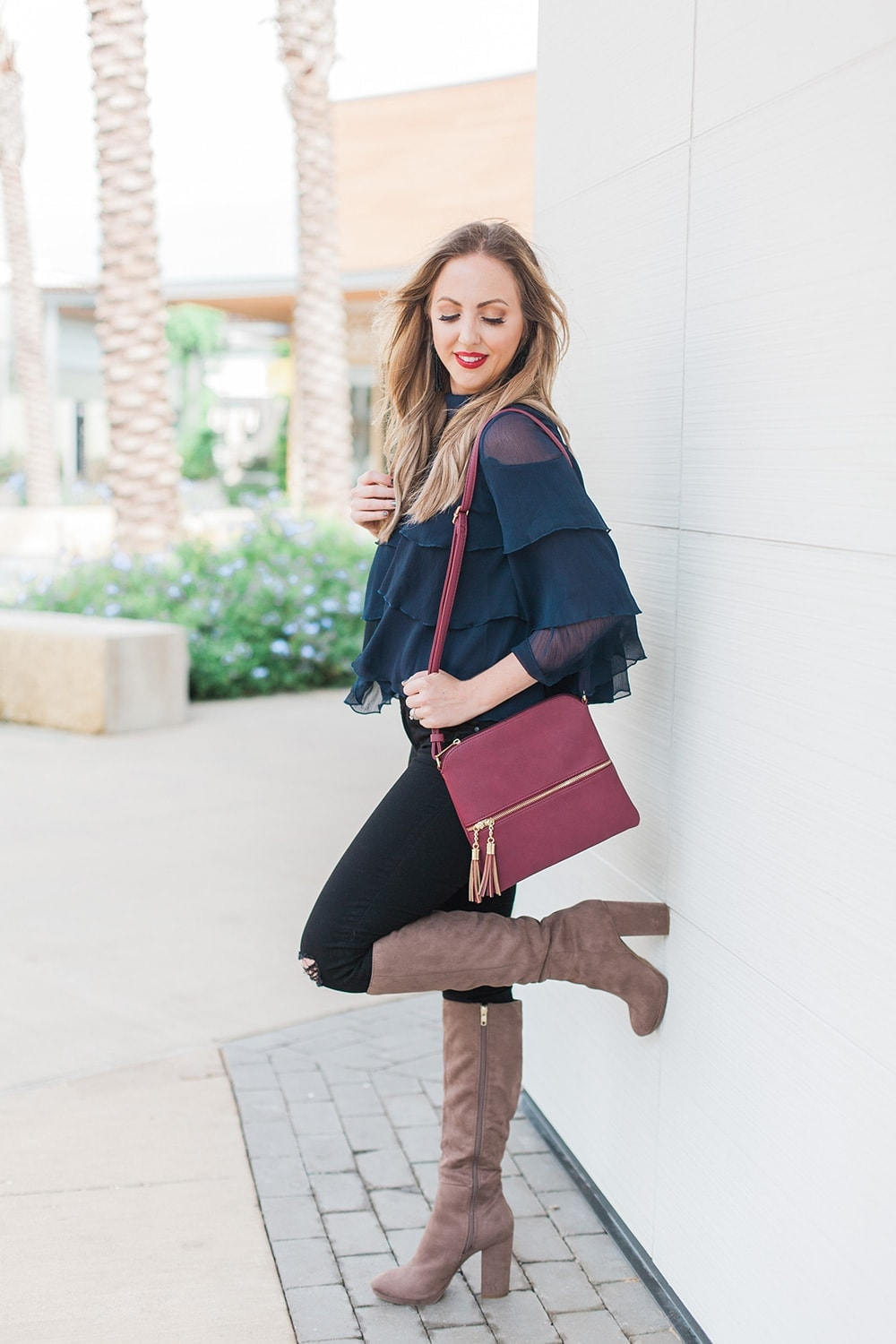 navy ruffle blouse with boots - perfect fall or holiday outfit