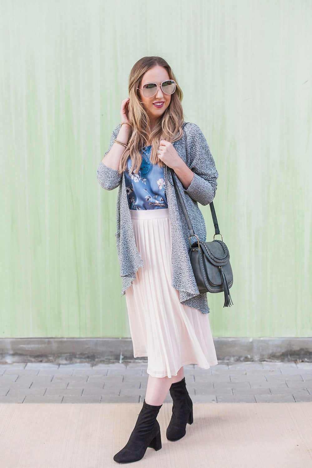 Pleated skirt with floral top, cardigan and boots