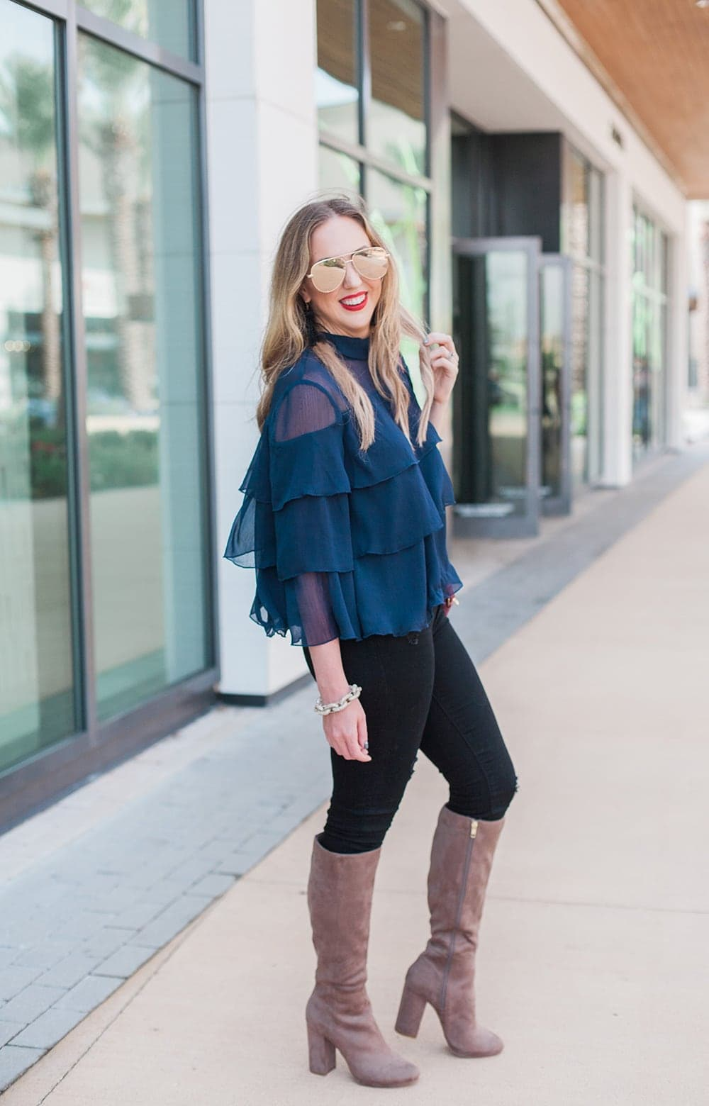 love this fall and holiday outfit! ruffle blouse with tall boots