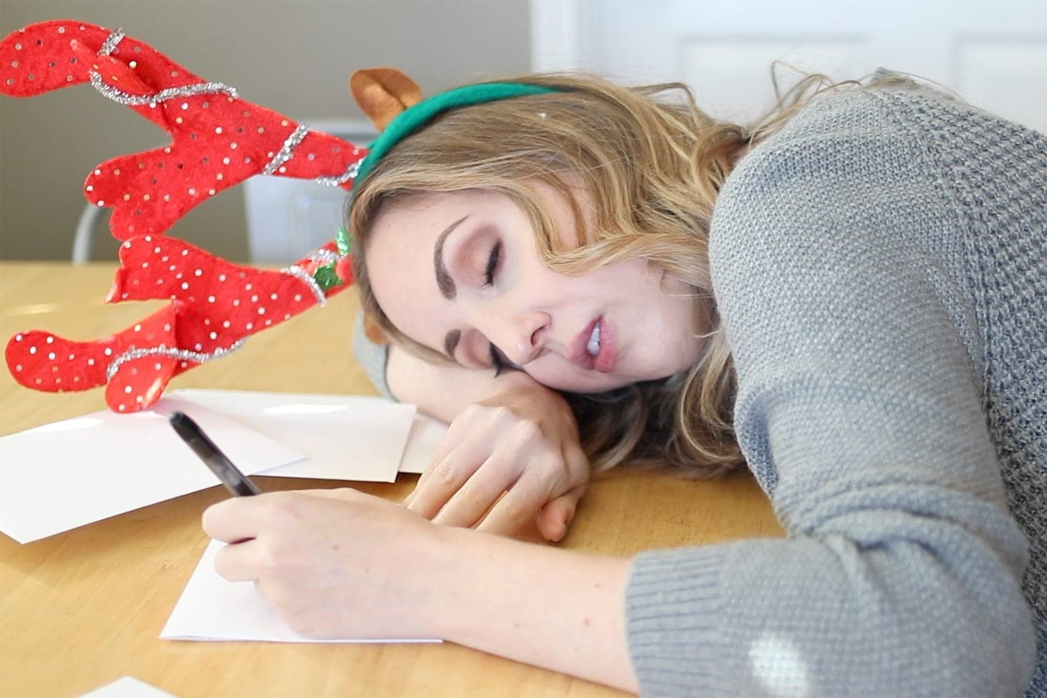 falling asleep while addressing Christmas cards - holiday bloopers by Houston blogger Meg O. on the Go