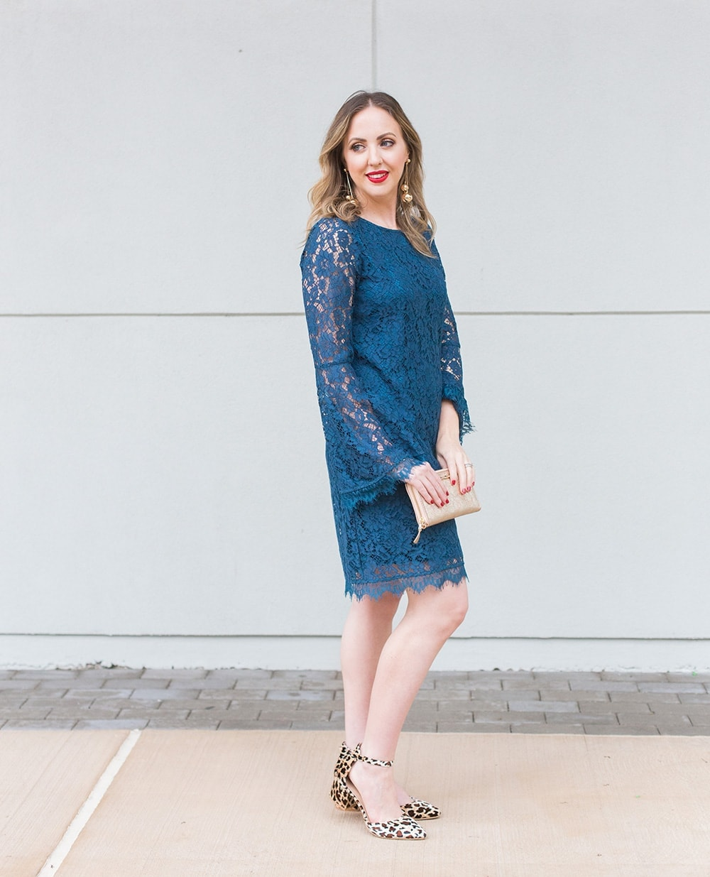 blue lace bell sleeve dress with gold earrings, red lipstick, gold clutch and leopard print shoes. Houston blogger Meg O. on the Go
