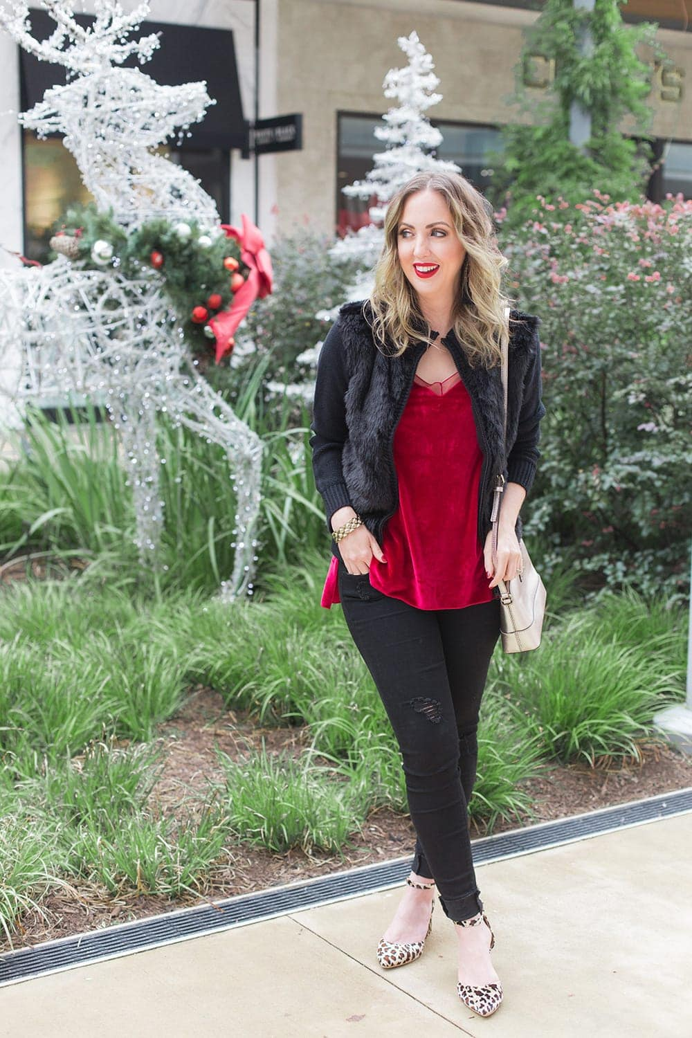 Holiday outfit idea - velvet tank, fur, black denim, and leopard block heels