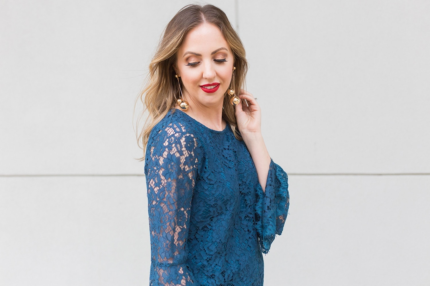 blue lace dress, gold earrings, and red lipstick. Photo of Houston blogger Meg O. on the Go