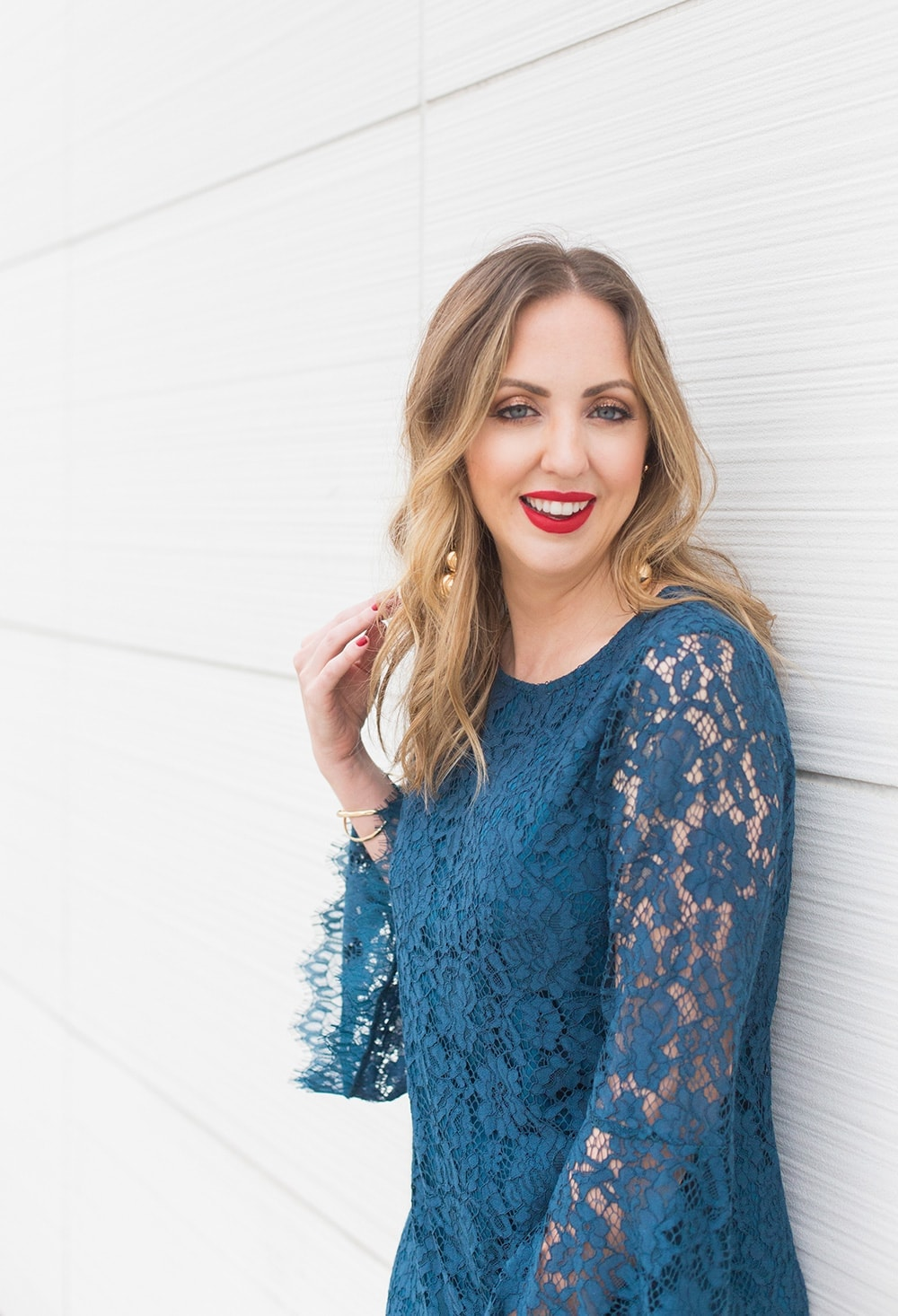 bold red lipstick with a blue lace dress