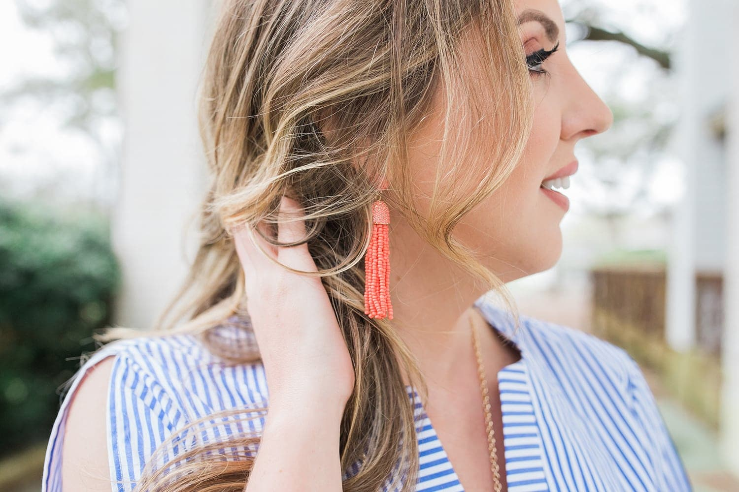 Houston blogger Meg O. on the Go shows some beautiful coral tassel earrings from the Avon Modern Southern Belle Collection