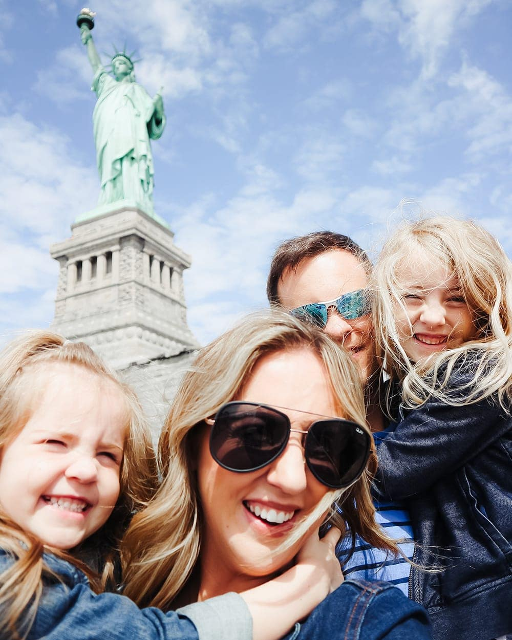 Statue of Liberty Family Photo - New York City Family Trip guide by mommy blogger Meg O. on the Go