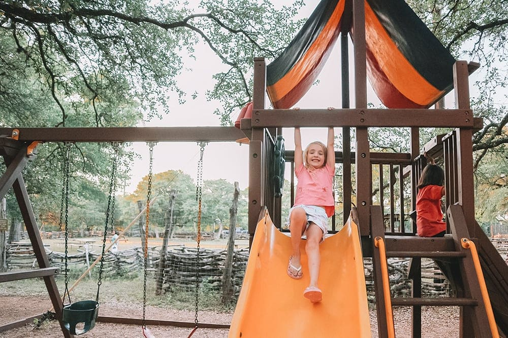 The Salt Lick BBQ in Driftwood, TX is the perfect family-friendly restaurant to visit. We love the playground!
