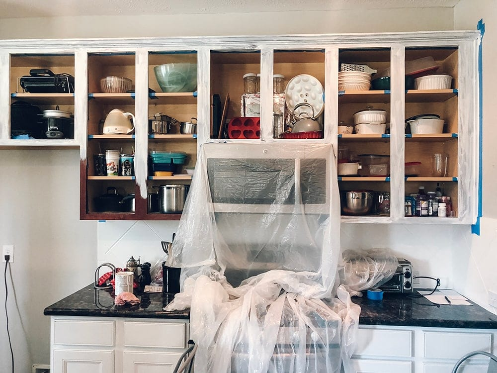 Houston blogger Meg O. on the Go shares how she painted her entire kitchen for under $250 - she painted her kitchen cabinets in sections