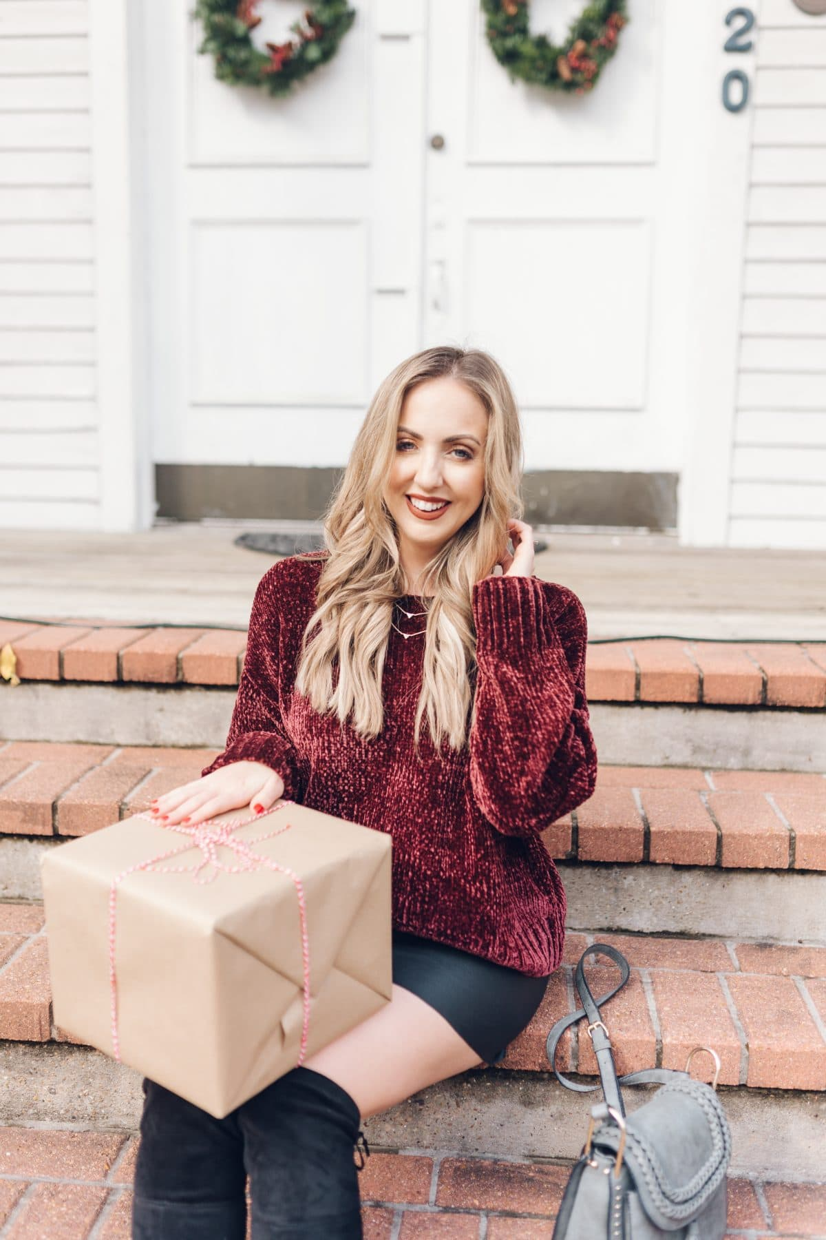 Houston blogger Meg O. on the Go shares a holiday outfit idea with a chenille sweater, faux leather skirt, and over the knee boots - all from Evereve