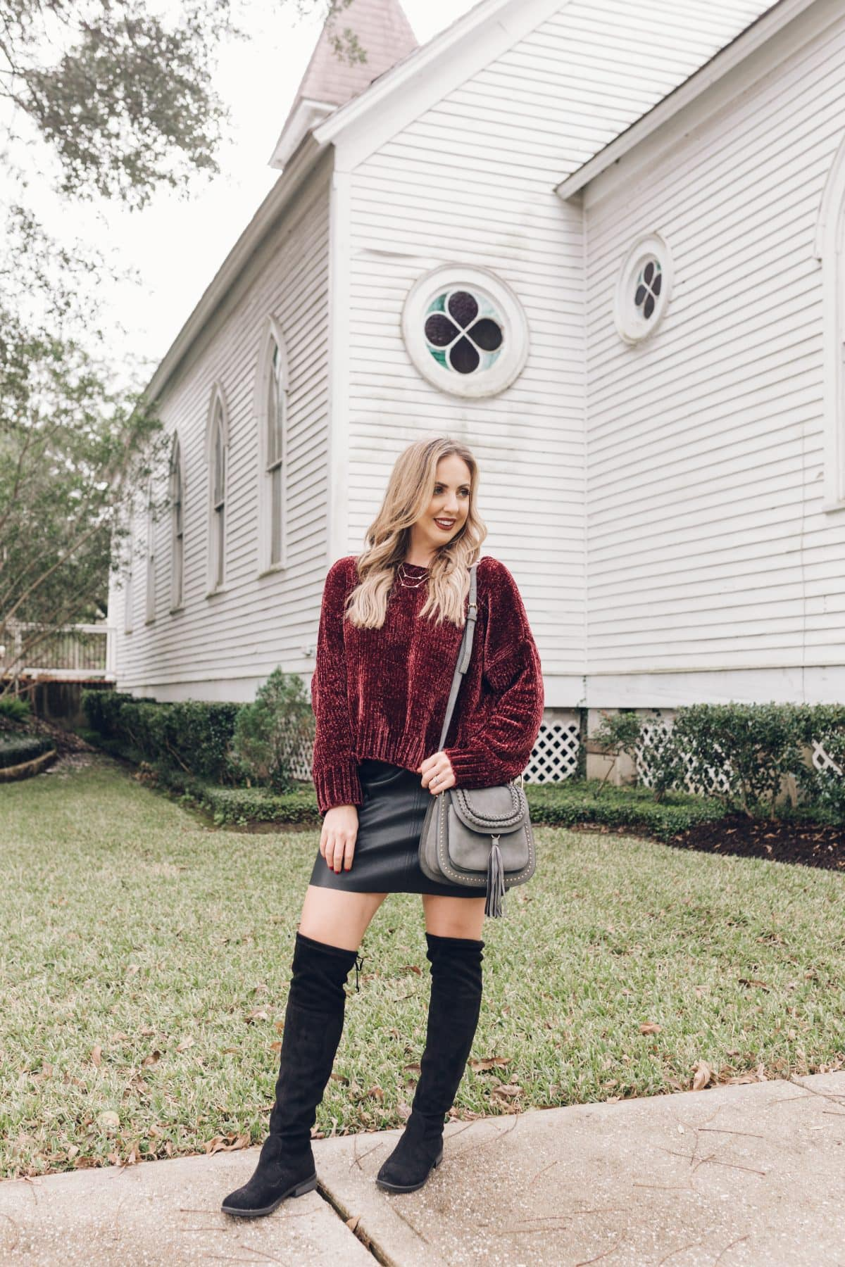 Houston lifestyle blogger Meg O. on the Go shares a holiday outfit that includes a chenille sweater, faux leather skirt, and over the knee boots - all from Evereve