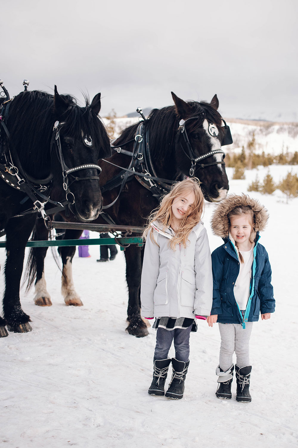 Houston blogger Meg O. shares her family trip to Winter Park Colorado - the sleigh ride at Devil's Thumb Ranch is a wonderful experience for the whole family!