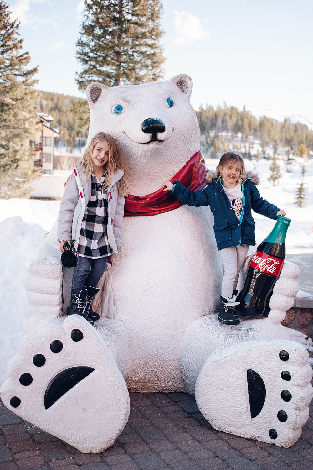 Houston blogger Meg O. shares her ski trip with kids to Winter Park Colorado - the Winter Park Resort village is so cute with the Coca Cola Bear