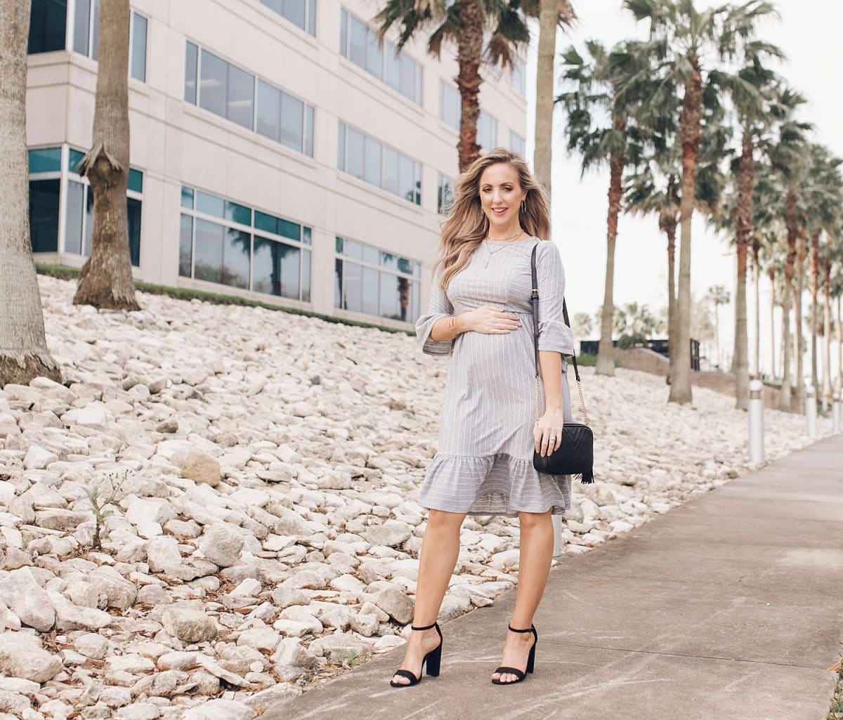 Houston lifestyle blogger Meg O. on the Go shares her favorite spring maternity dresses - this grey striped ruffle trim dresss with 3/4 sleeves is perfect for spring!