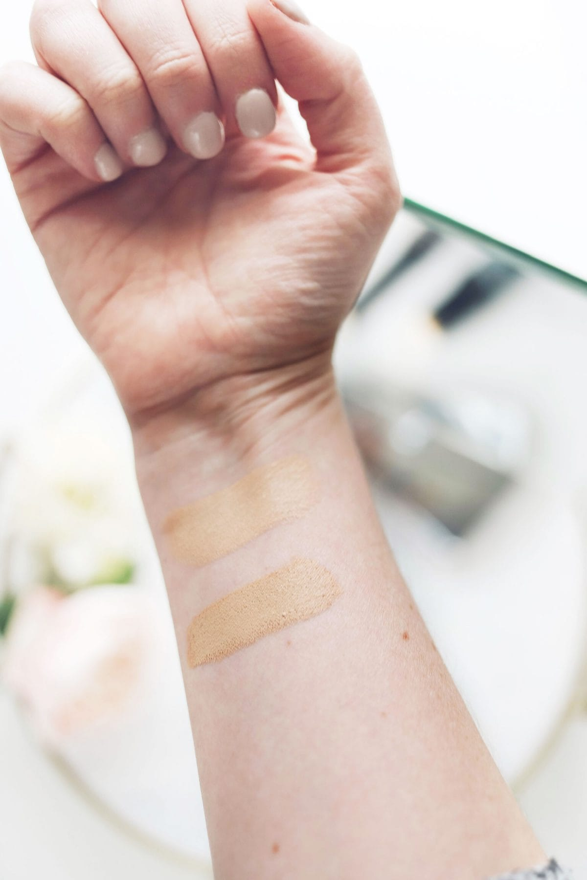 Houston beauty blogger Meg O. on the Go shares a dupe for the Hourglass Vanish Stick Foundation! Showing stick foundation swatches - Wet 'n Wild on top and Hourglass on the bottom
