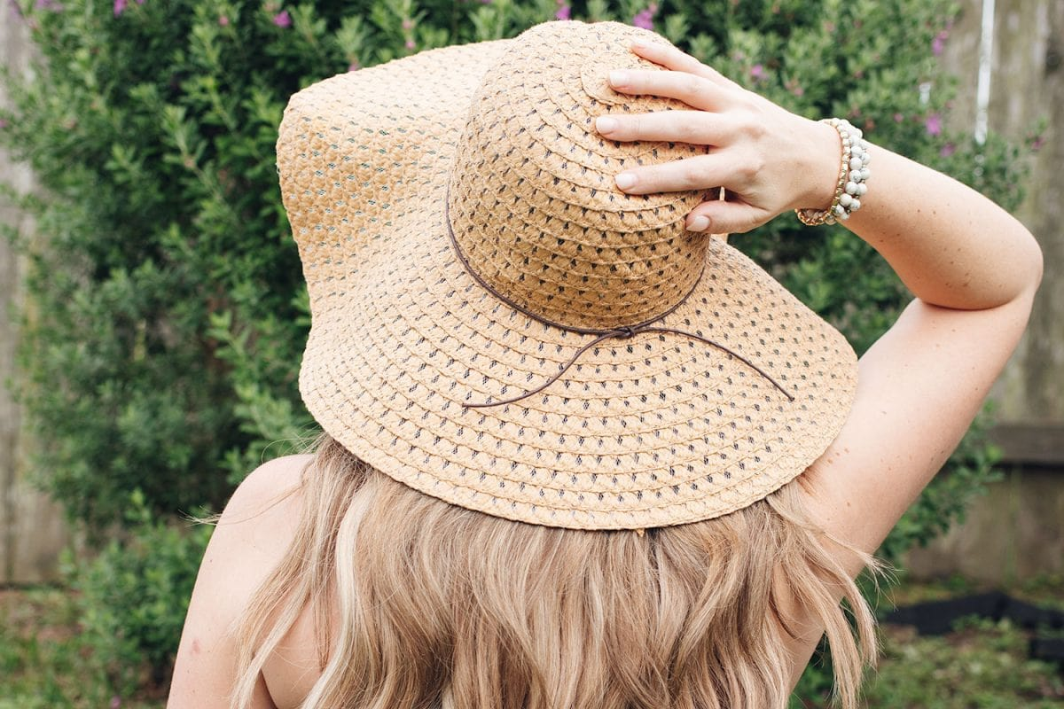 Houston beauty blogger Meg O. on the Go shares how to keep your hair healthy in summer - always wear a hat for sun protection!