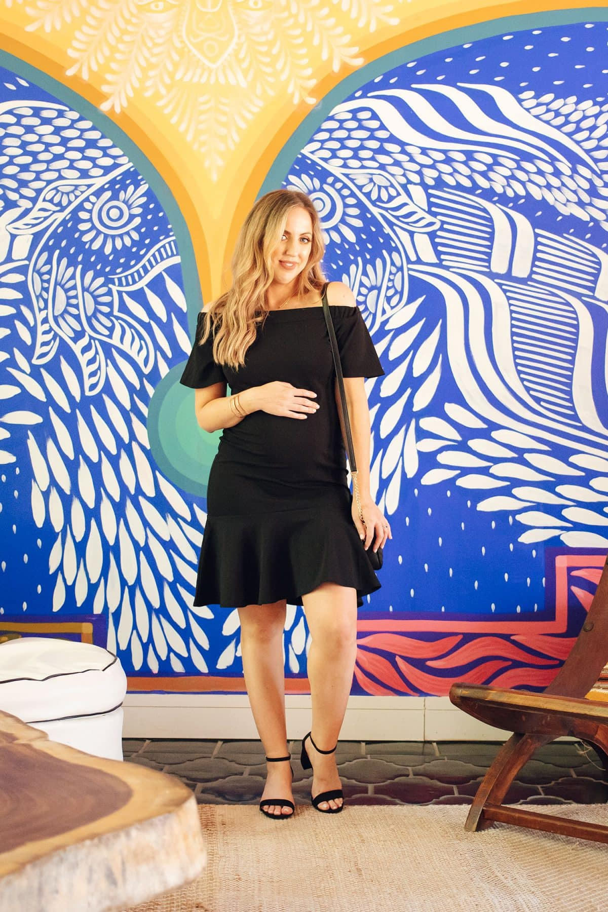Houston mommy blogger Meg O. on the Go shares 3 maternity outfit ideas for spring and summer - little black dress from Pink Blush