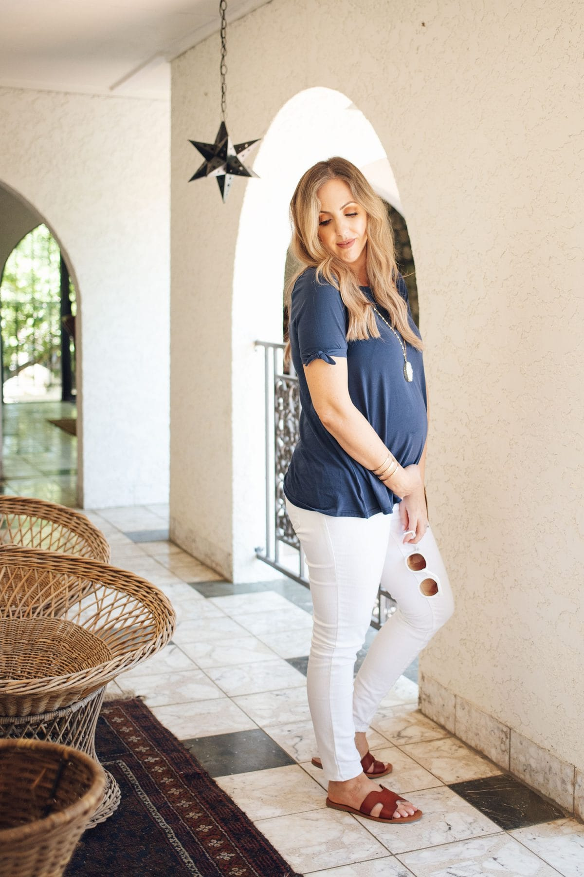 Houston mommy blogger Meg O. on the Go shares 3 maternity outfit ideas for spring and summer - love the navy top with white jeans