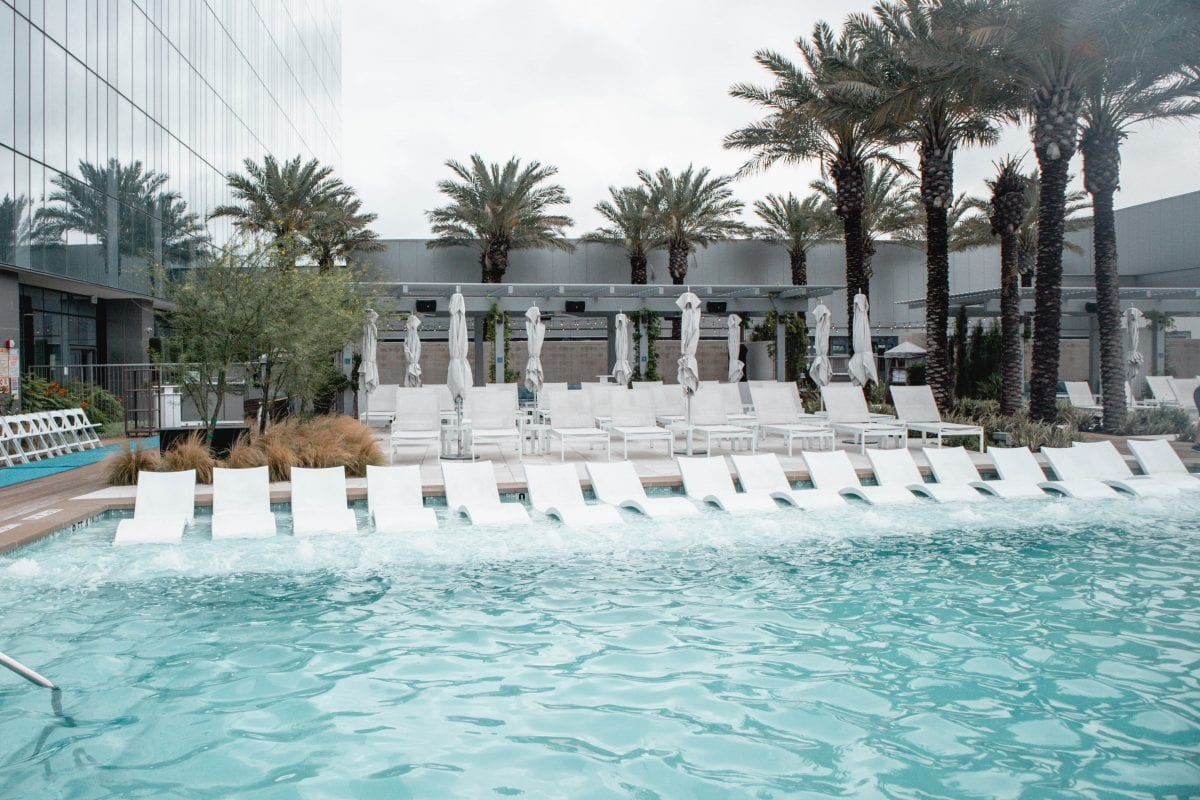 Houston lifestyle blogger Meg O. on the Go shares her couples' getaway to the Fairmont Hotel Austin TX - The Fairmont Austin Pool is gorgeous