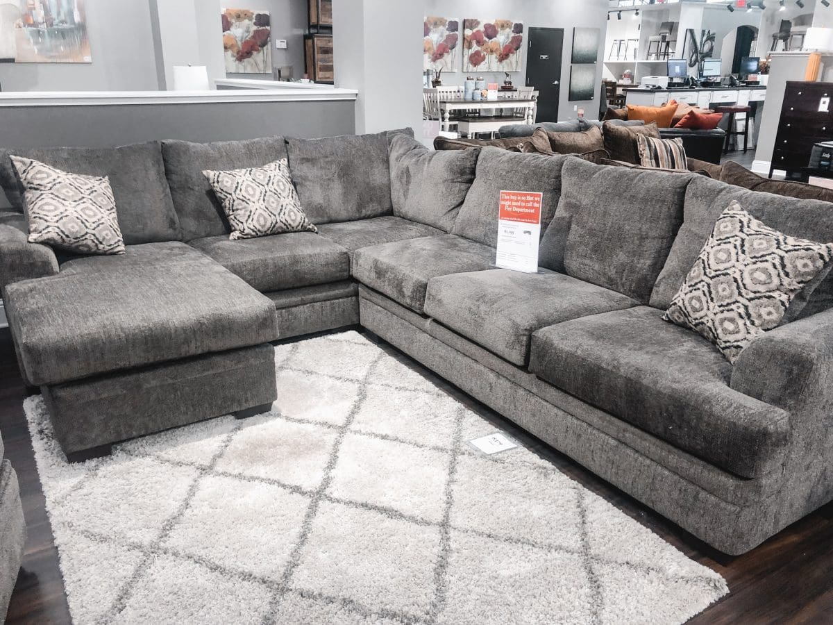 Houston blogger Meg O. on the Go shares her furniture buying experience with Exclusive Furniture Houston - Cypress and Webster locations. Love this huge section with an amazing price tag!