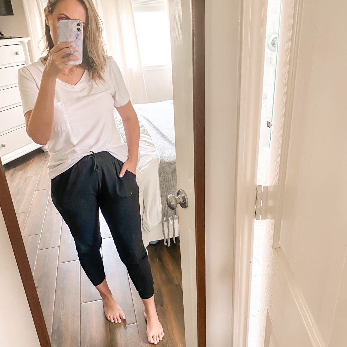 Amazon comfy clothes and athleisure - black joggers and white slouchy v-neck tee from Amazon