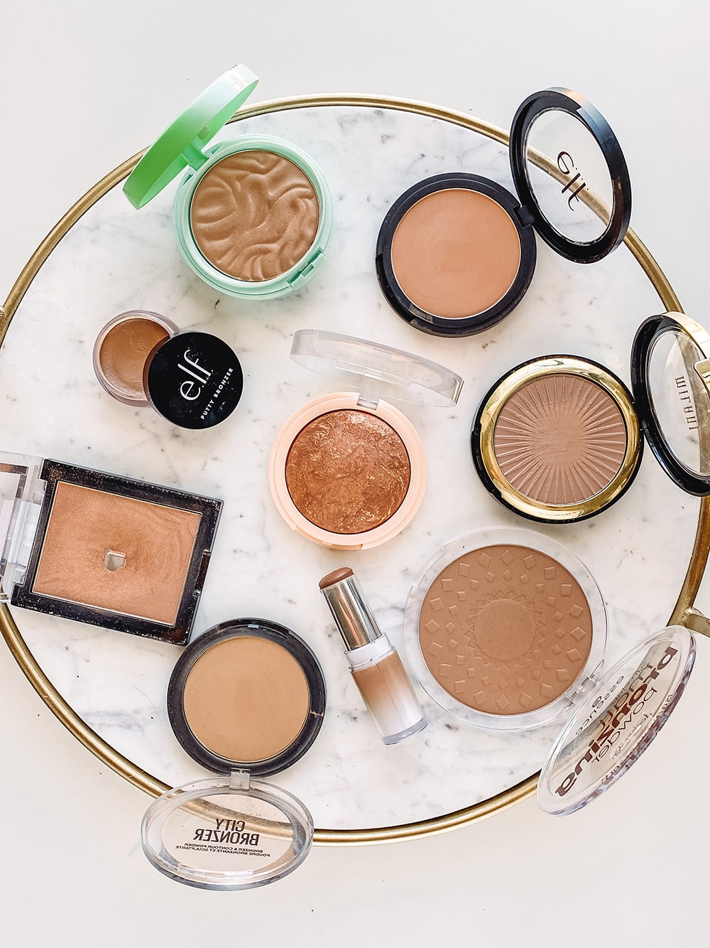 Houston beauty blogger Meg O. shares the best drugstore bronzers for sun kissed skin. This list includes different formulas and finishes that will work for all skin tones and types!